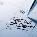 Close up de un calendario/agenda importante con nota escrita. Concept: programas de administración de deudas