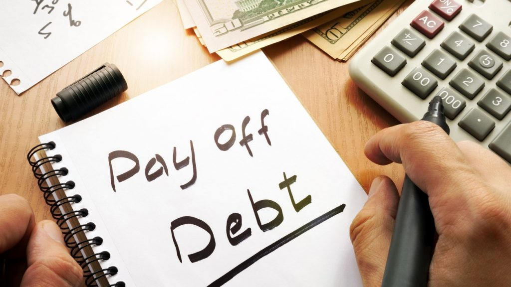 Note with words pay off debt concept. concept: Debt Management Program