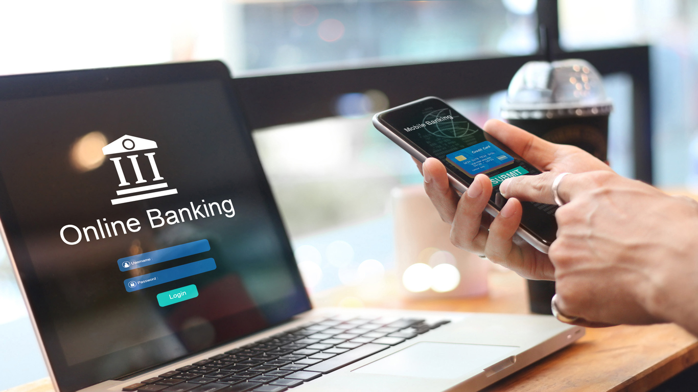 Man using online banking with credit card on touch screen device. Mobile banking. Digital and internet payments shopping on network connection. Bank login on a laptop screen. All on screen and credit card are design up. concept: best online banking