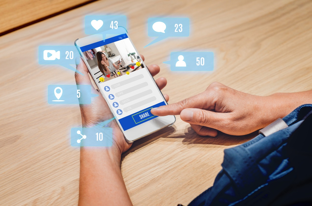 woman share view of beauty blogger review online with mobile apps on wood table at home,online influencer technology in daily lifestyle,Digital age. concept: facebook stories