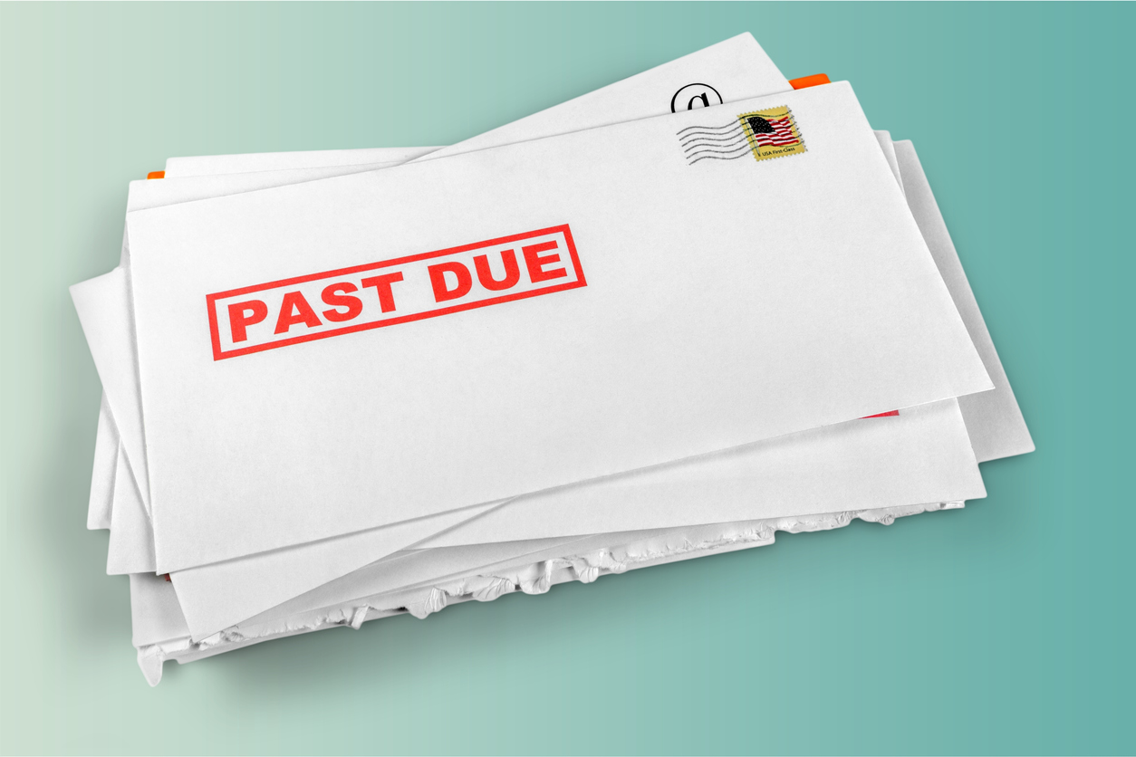 Pile of envelopes with overdue utility bills. concept: back taxes