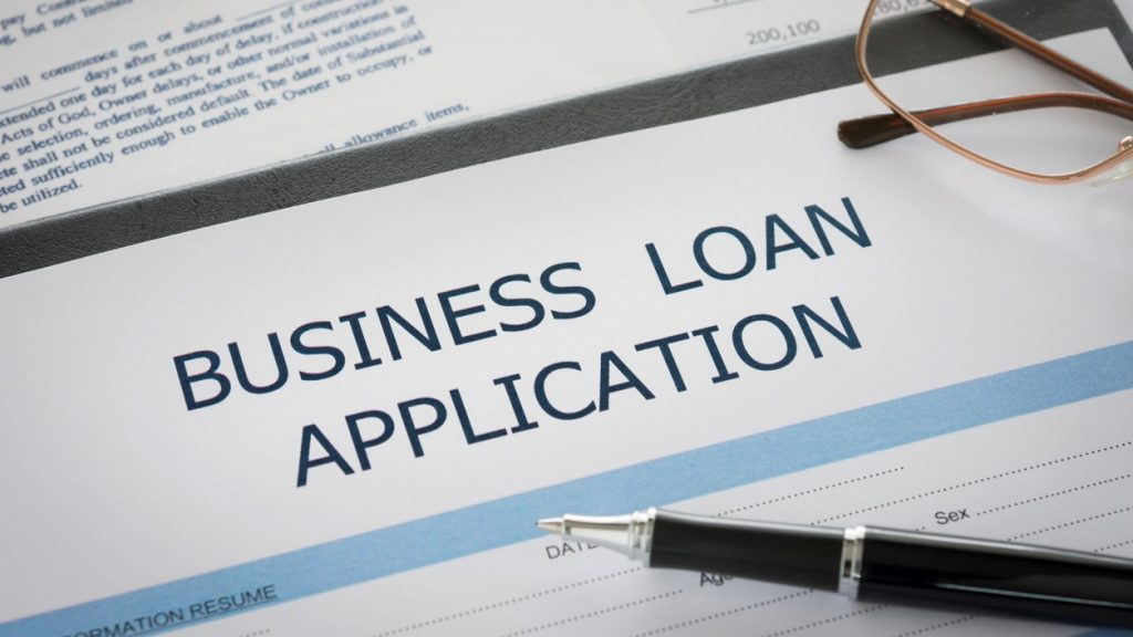 Business loan application form on desk in bank. Concept: loan broker