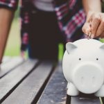 woman hand putting coin into piggy for saving money wealth and financial concept. Concept: investment accounts