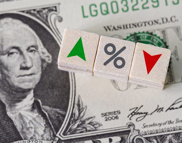 Concept idea of FED, federal reserve system is the central banking system of the united states of America and change interest rates. Percentage icon and arrow symbol on wooden cube. concept: new tax rates