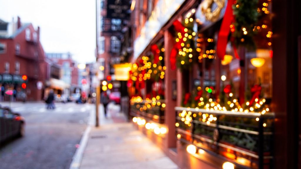 blurred background. Christmas lights and Christmas decorations on the street. concept: business hours