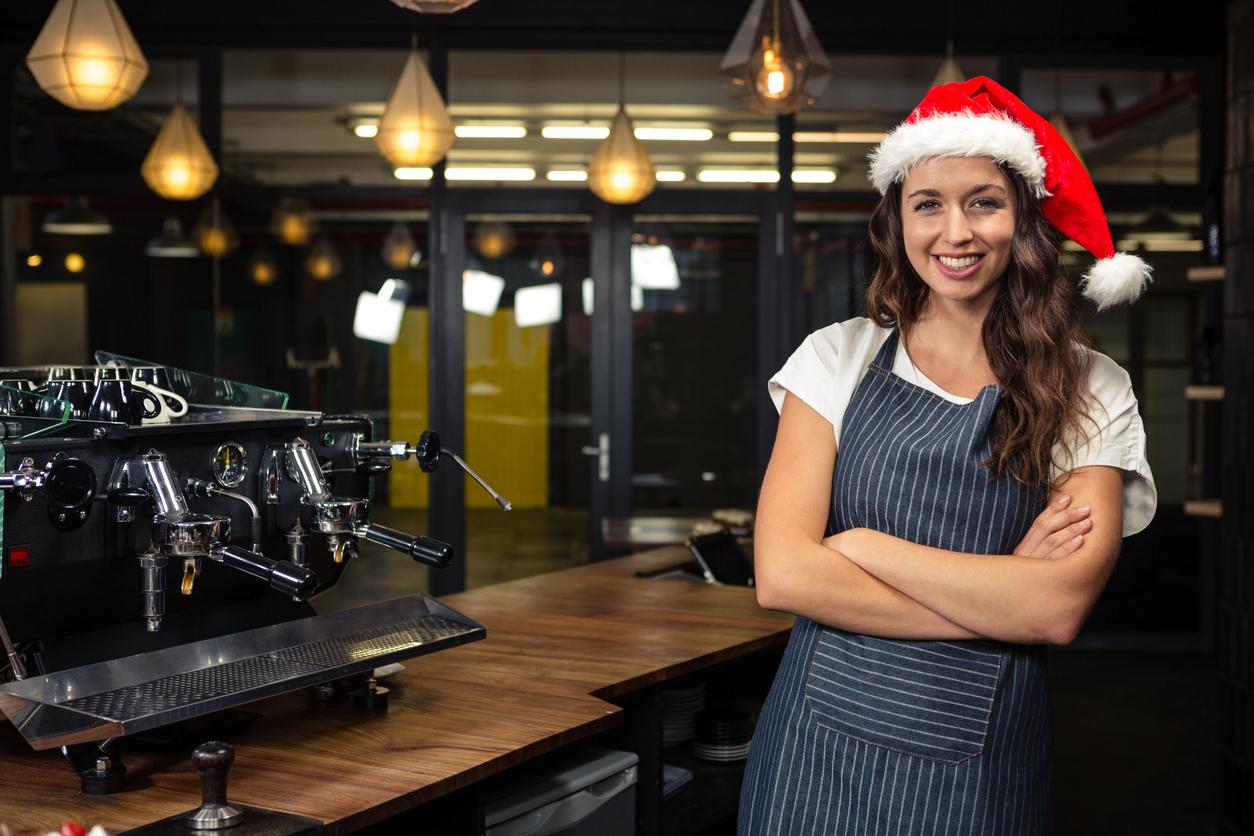 Restaurant owner wearing santa hat. Concept: Restaurant work-life balance during the holiday season