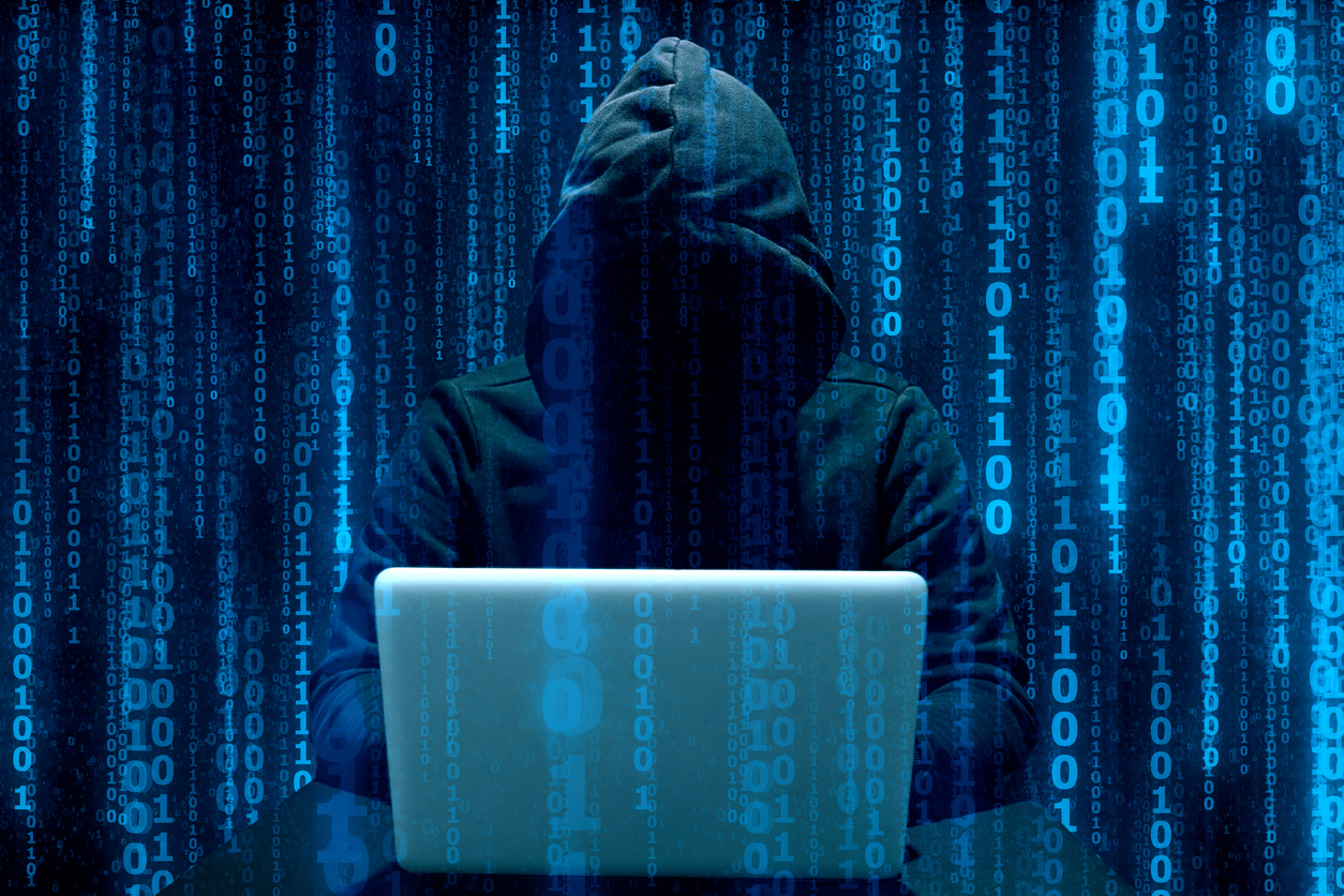 Faceless hooded anonymous computer hacker. Concept: cyber liability insurance