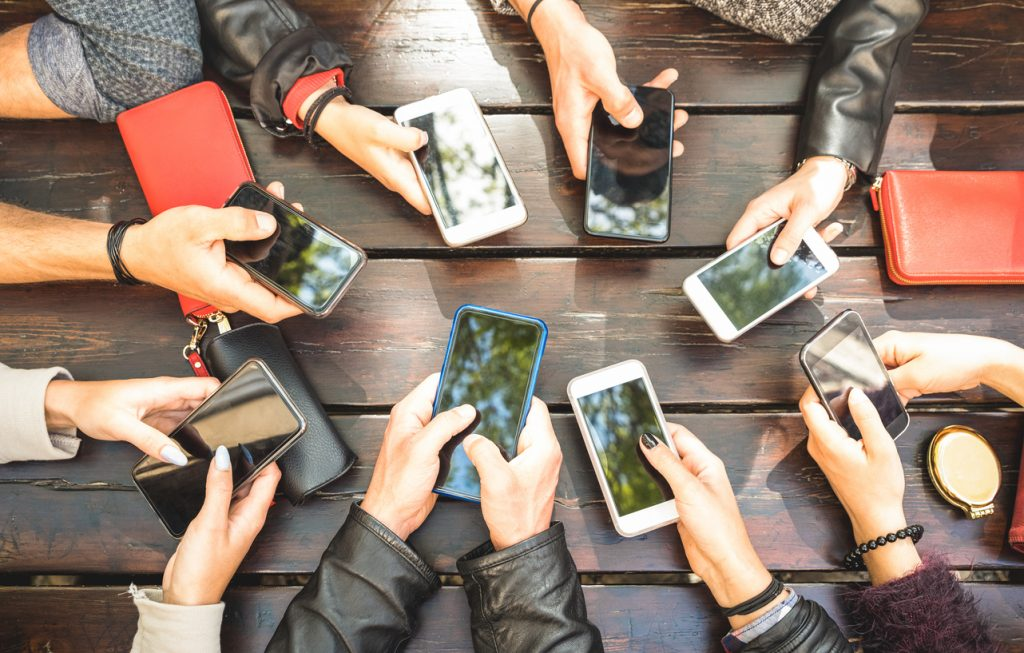 People group having addicted fun together using smartphones - Detail of hands sharing content on social network with mobile smart phones - Technology concept with millennials online with cellphones. concept: How to Start a Cleaning Business