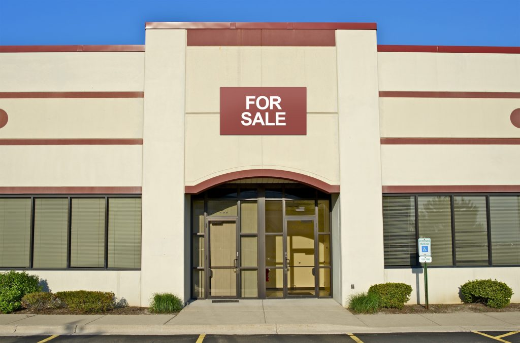 Commercial building for sale. Concept: selling a business