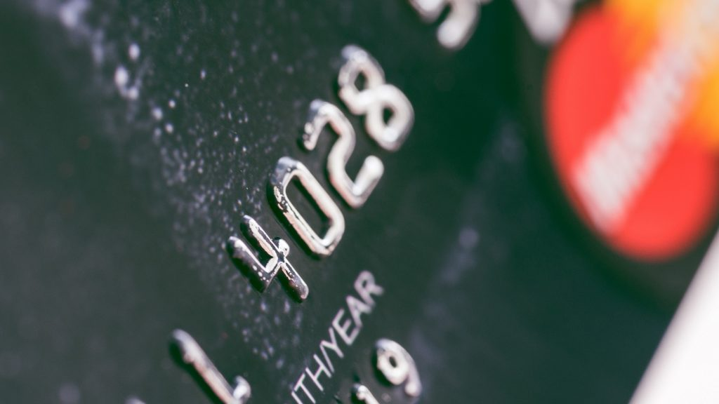 Debit card bank numbers closeup. picjumbo.com. conept: recurring payments