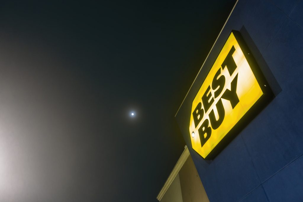 New Orleans, USA - Dec 3, 2017: Lit up exterior sign of a local Best Buy store. Some evening fog visible. Best Buy is America's premier electronics specialty franchise chain. concept: Best Buy For Business