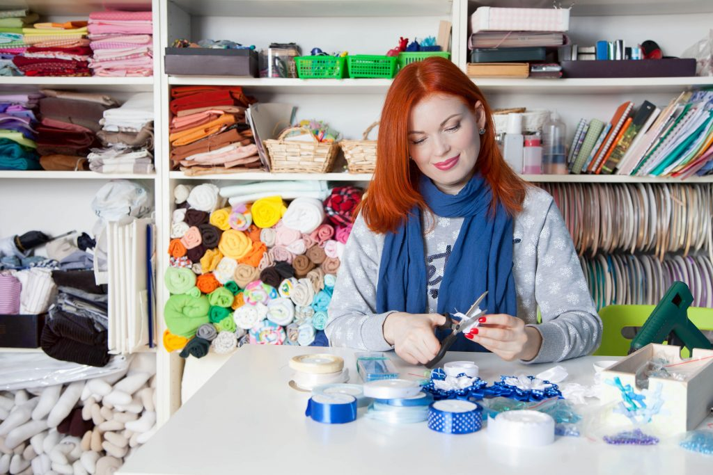 Woman working on hand-made crafts. Concept: How to start an Etsy shop