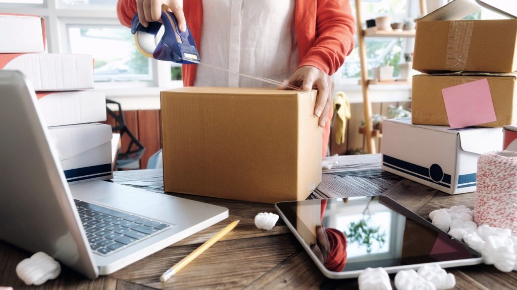 Business Start up SME concept. Young startup entrepreneur small business owner working at home, packaging and delivery situation. concept: Shopify vs Amazon