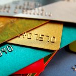 stack of multicolored credit cards, close up view with selective focus. concept: Secured vs Unsecured Credit Cards