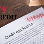 Credit application with Approved stamp. Concept: 5 C's of credit.
