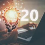 Number 2020 with hand and bulb. Concept: best business to start in 2020.
