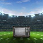 Estadio de footbal, fútbol, americano con una televisión en el centro. concept: anuncios super bowl