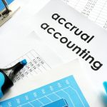 Accrual accounting document on a table. concept: Accrual Basis Accounting