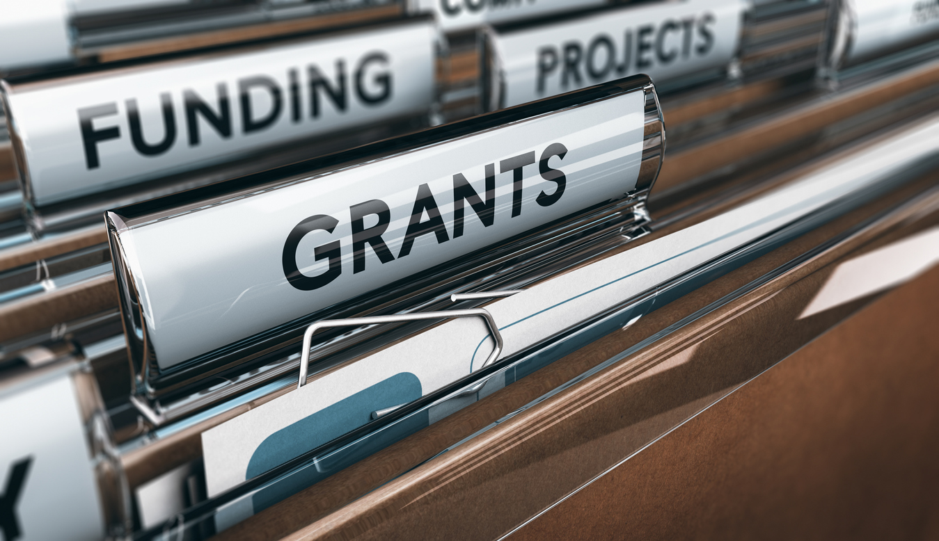 View of brown folders, with focus on grants label, Concept of funding, 3D illustration. concept: SBA grants