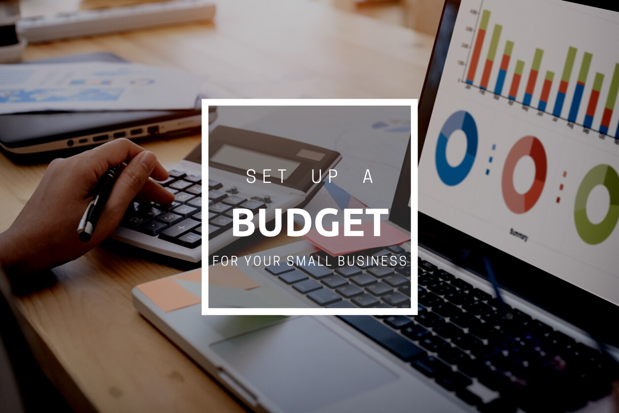 business woman uses a calculator to calculate the company's performance figures, graphs the monthly graphs for the meeting. concept: how to set up a budget