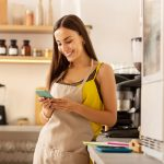 Female business owner using a credit monitoring service