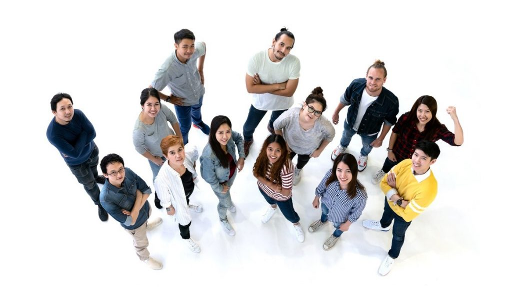 Group of Diversity People Team smiling with top view. Ethnicity group of creative teamwork in casual happy lifestyle together with copy space. Different in staff generations concept Banner. concept: marketing to millennials