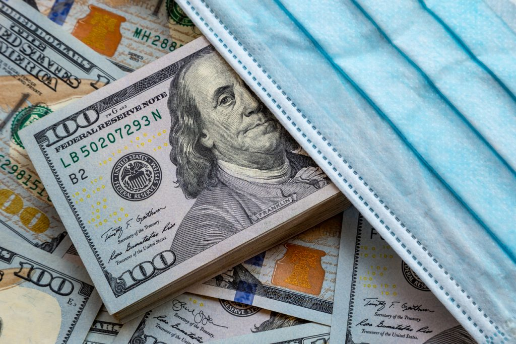Banknotes of the United States of America and a protective mask against the virus. World economic crisis associated with coronovirus. concept: coronavirus SBA Small Business Relief Programs