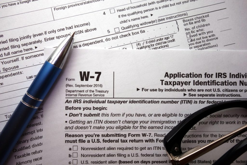 W-7 irs federal tax form closeup, ITIN renewal concept