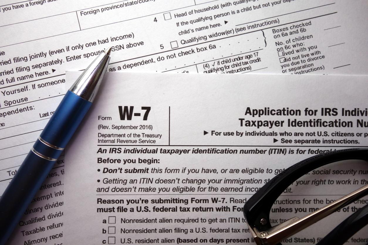 W-7 irs federal tax form closeup, ITIN renewal concept