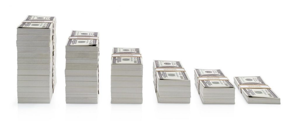 Increasing piles of dollar bills isolated on white background. concept: cleaning business