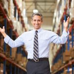 Immigrant business owner in warehouse with open arms. Concept: How to begin investing