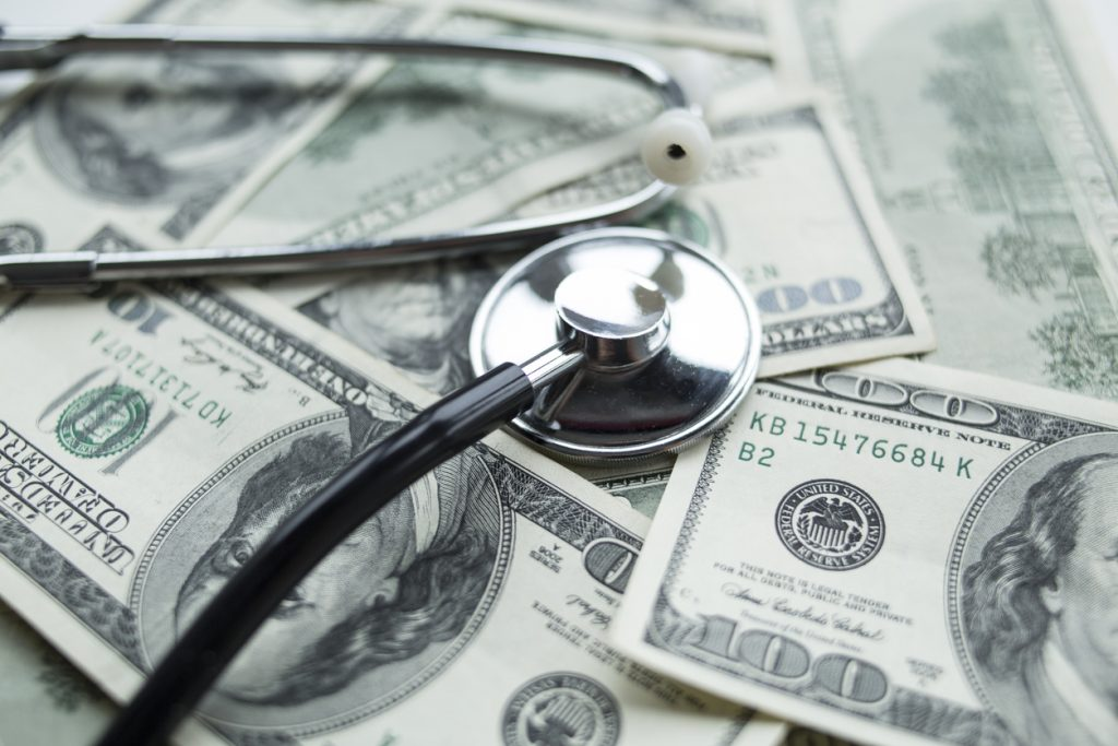 Medical costs. Stethoscope on the dollars. concept: medical loans