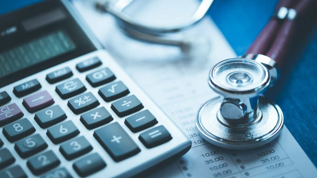 Stethoscope And Calculator. Concept: medical loans