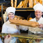 Backery owners selling fresh bread- mom and pop business.