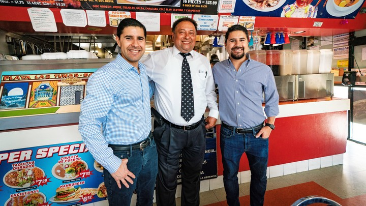Sean and Kenny Salas with Camino Financial member. Concept: Camino Financial Latinx Small Business Survey.