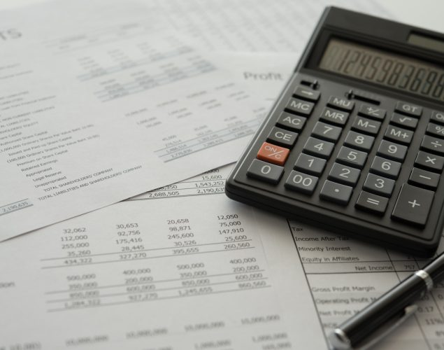 bookkeeping accounting concept. calculator on financial statement and balance sheet annual. concept: PPP Loan Calculation