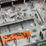 Busy construction site and construction equipment aerial top view. concept: Construction during coronavirus