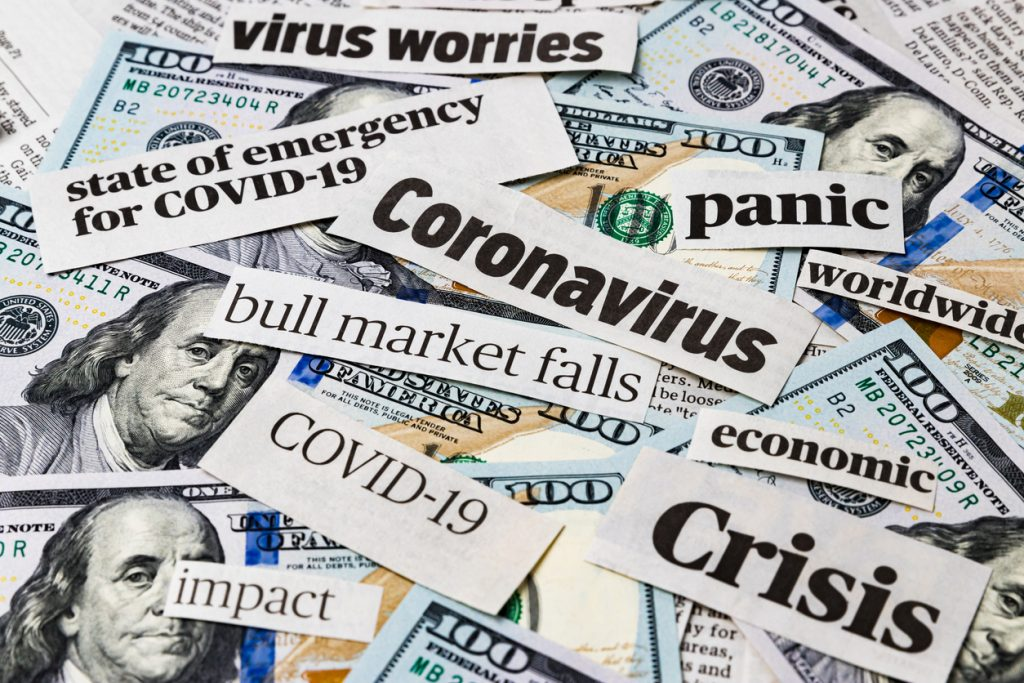 Coronavirus, covid-19 news headlines on United States of America 100 dollar bills. Concept of financial impact, stock market decline and crash due to worldwide pandemic. concept: new economy
