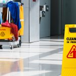 Janitorial and mop bucket on cleaning in process. concept:commercial cleaning services
