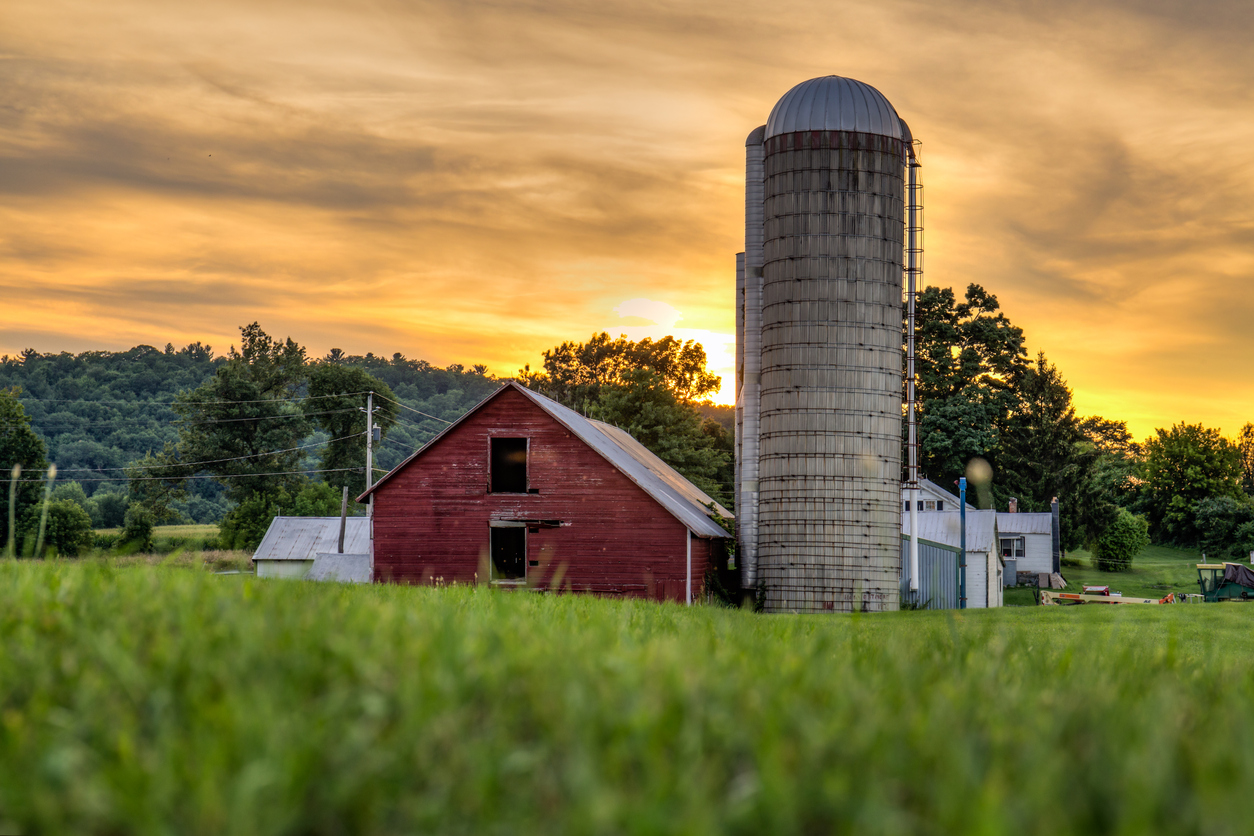 The barn during a moody sunset in the Berkshire Mountains. concept: farm financing
