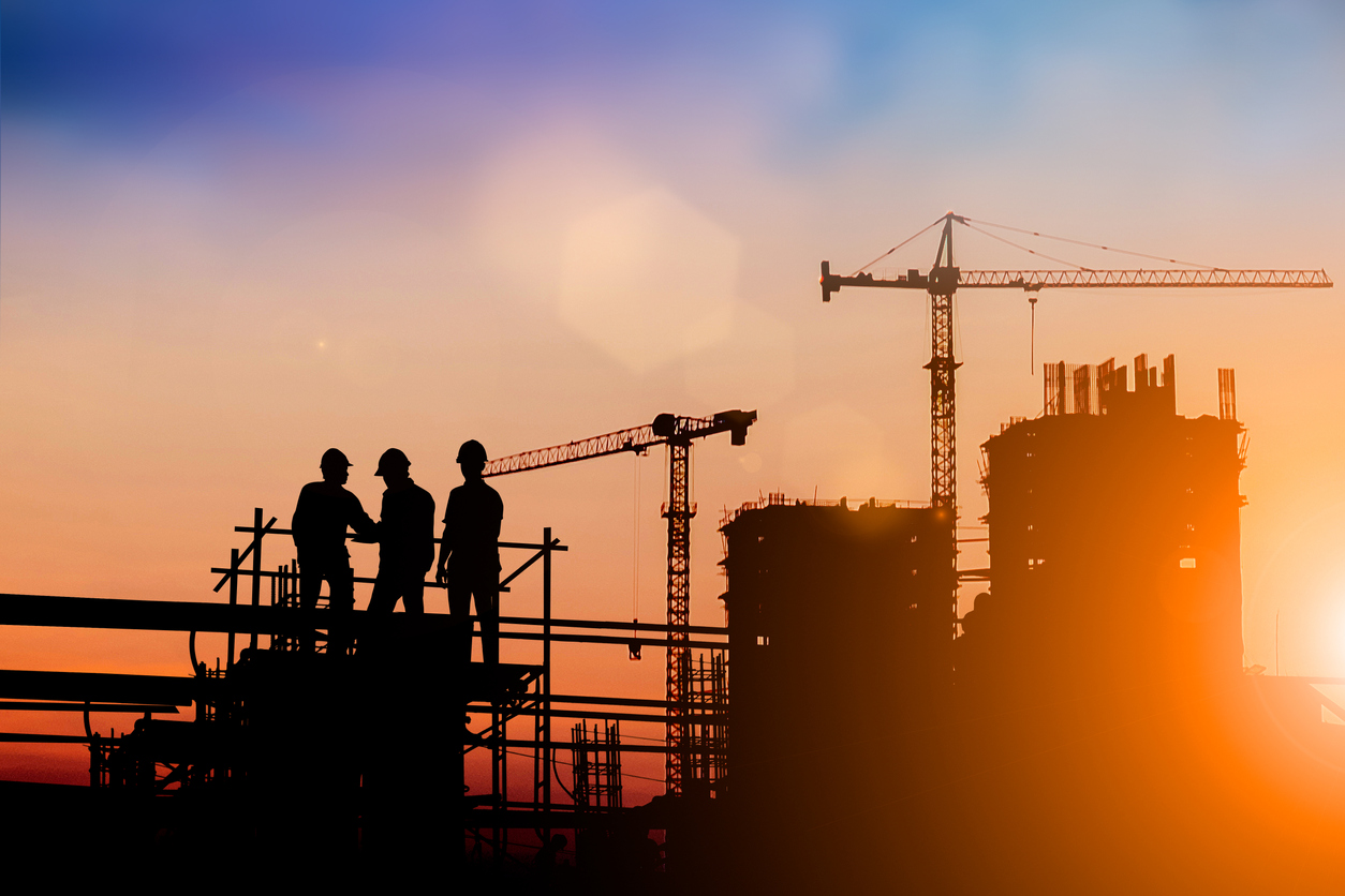 Silhouette of engineer and construction team working at site over blurred background for industry background with Light fair.Create from multiple reference images together. concept: Construction industry trends