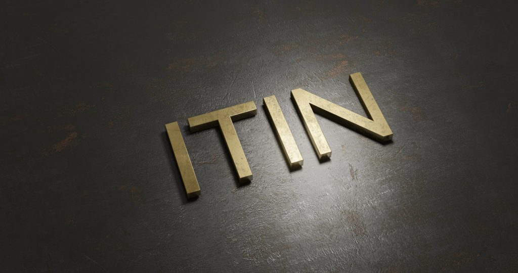 3d rendering gold - ITIN - written on textured rustic black metal positioned in a diagonal line. concept: itin number
