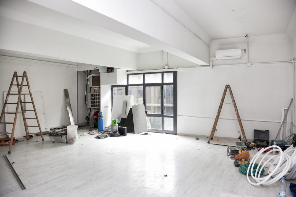 Construction works for the renovation of an office space and installing air conditioning. concept: COVID renovations