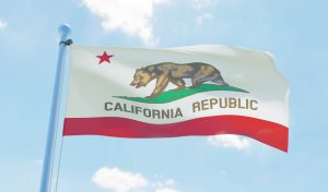 California (USA) flag waving against blue sky. 3d image. concept: California Small Business Grants