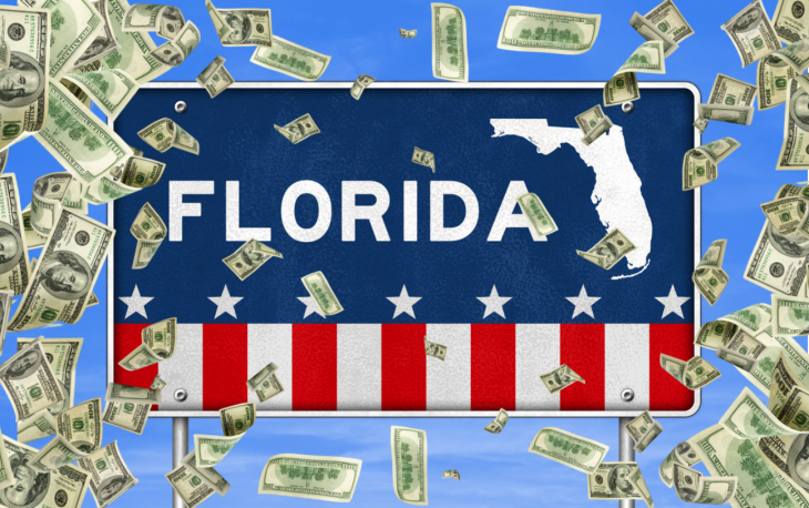 Florida - road sign with money. concept: Small Business Loans in Florida