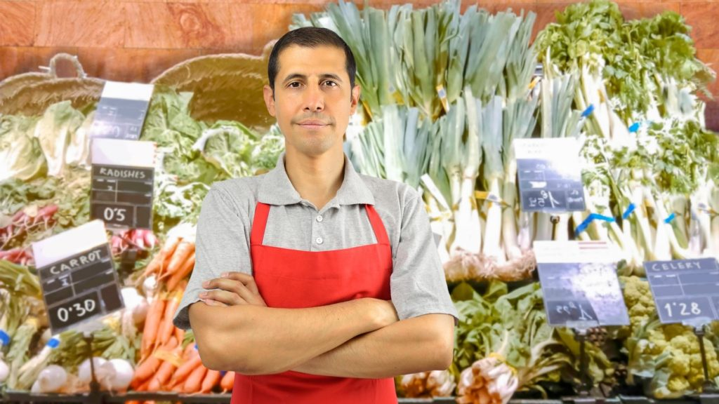 portrait of shopman at the vegetables store with crossing arms. concept: small business saturday