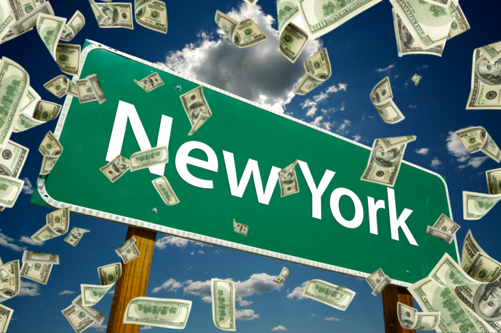 New York Road Sign. money falling. concept: small business loans in new york