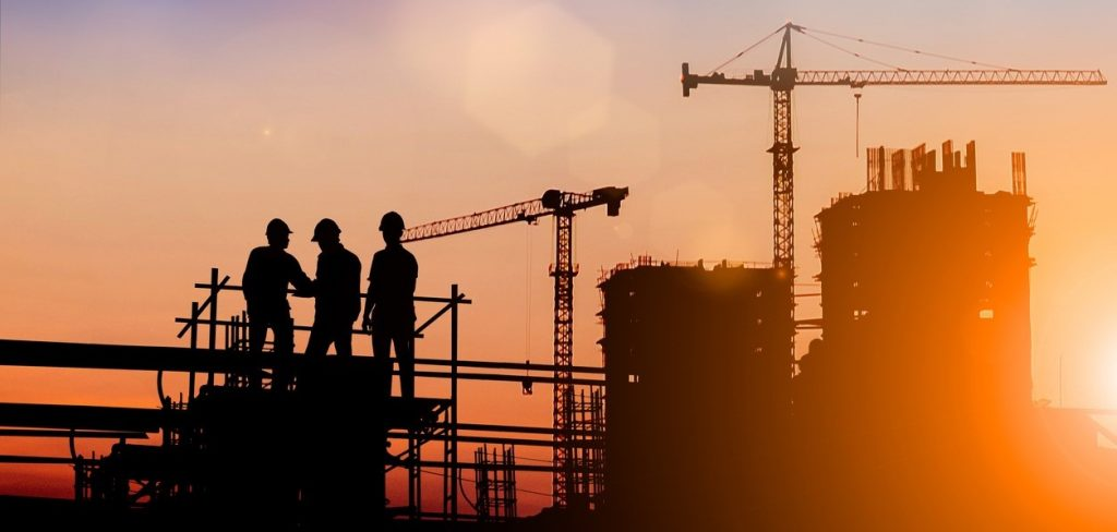 Silhouette of engineer and construction team working at site over blurred background for industry background with Light fair.Create from multiple reference images together. concept: construction success story