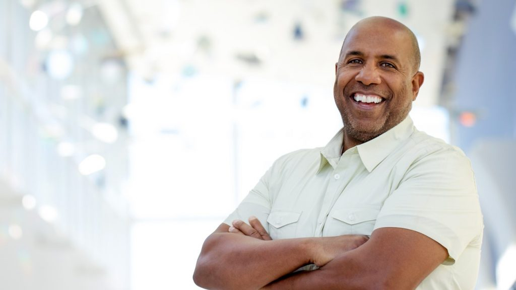 Mature African American smiling and looking at the camera. concept: Small Business Plan