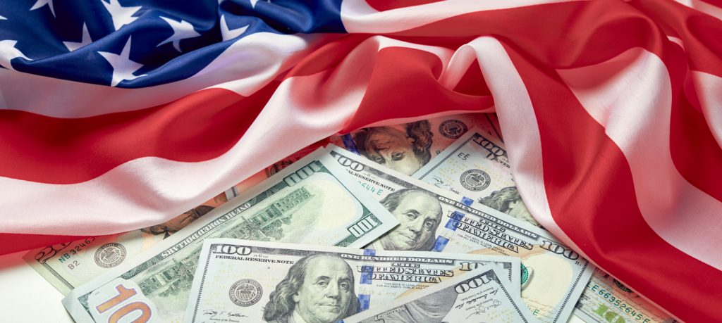 Close up of american flag and dollar cash money. Dollar banknote and United States flag on a background. Economy of USA. concept: Biden policies